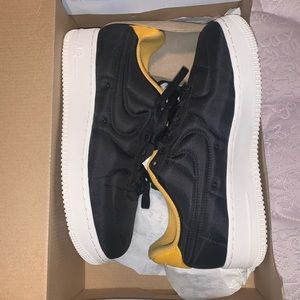 Black and yellow Nike air forces